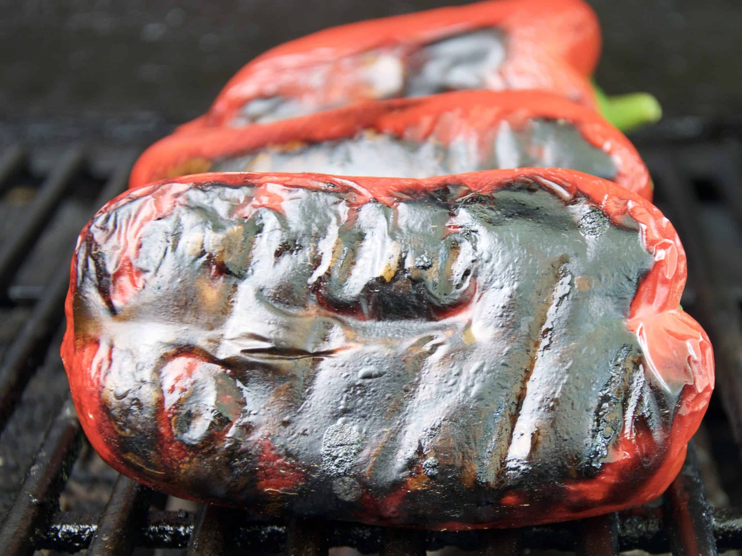 Chargrilled bell peppers on chargrill showing black skin