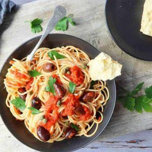 Puttanesca Pasta Sauce in a black bowl