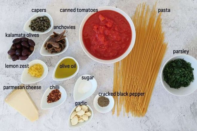 ingredients to make puttanesca on a grey table