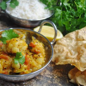 Cauliflower, lentil and tomato curry