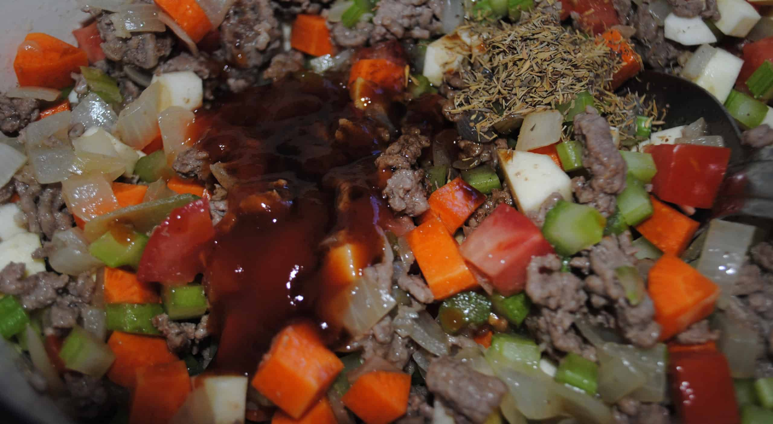 shepherds pie - sauces, salt, pepper and thyme added to pan
