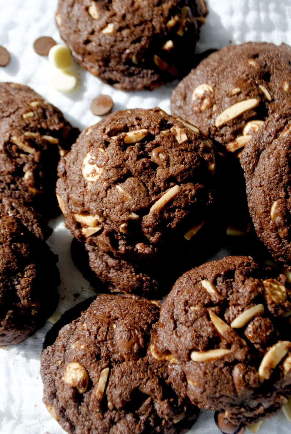 chocolate almond cookies cooling on a rack after being baked