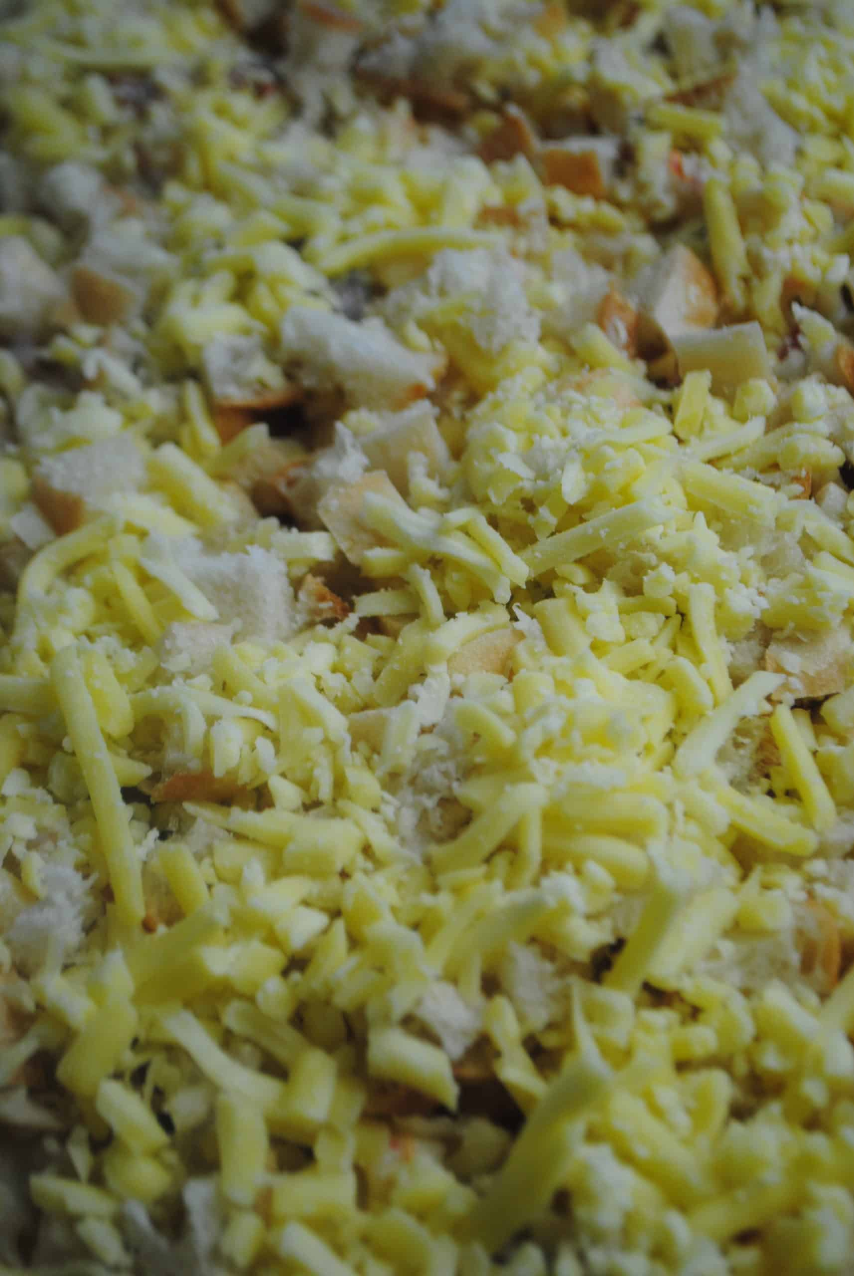macaroni with salami, tomato and mushroom with breadcrumbs and cheese topping in baking dish