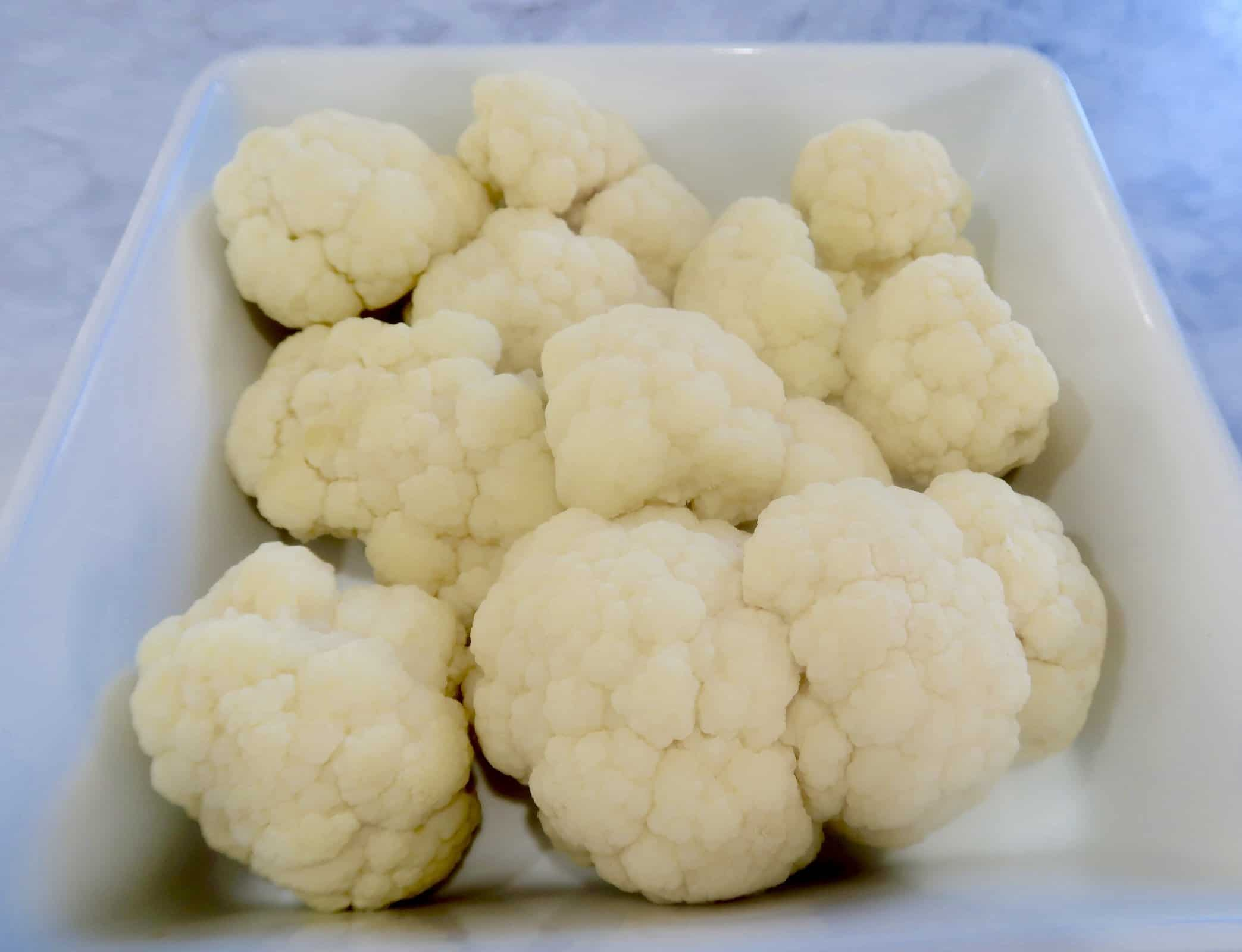 cauliflower with blue cheese gratin steamed florets in white ceramic baking dish