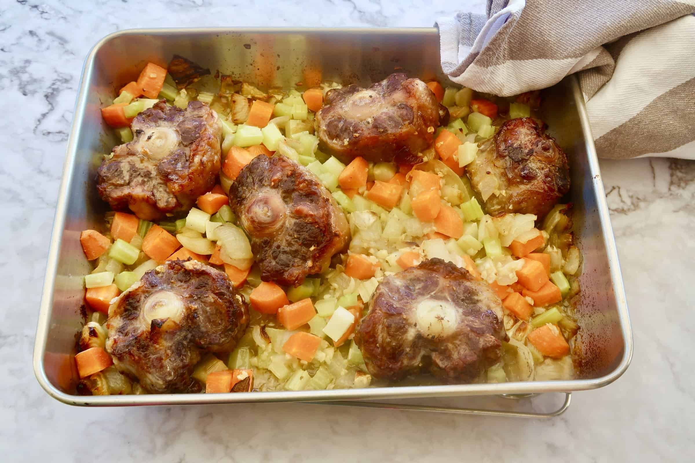 oxtail ragu roasted oxtail with onions, carrots and celery in baking dish