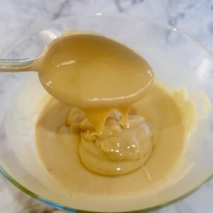 prawn cocktail sauce mixed in a glass bowl with a silver spoon