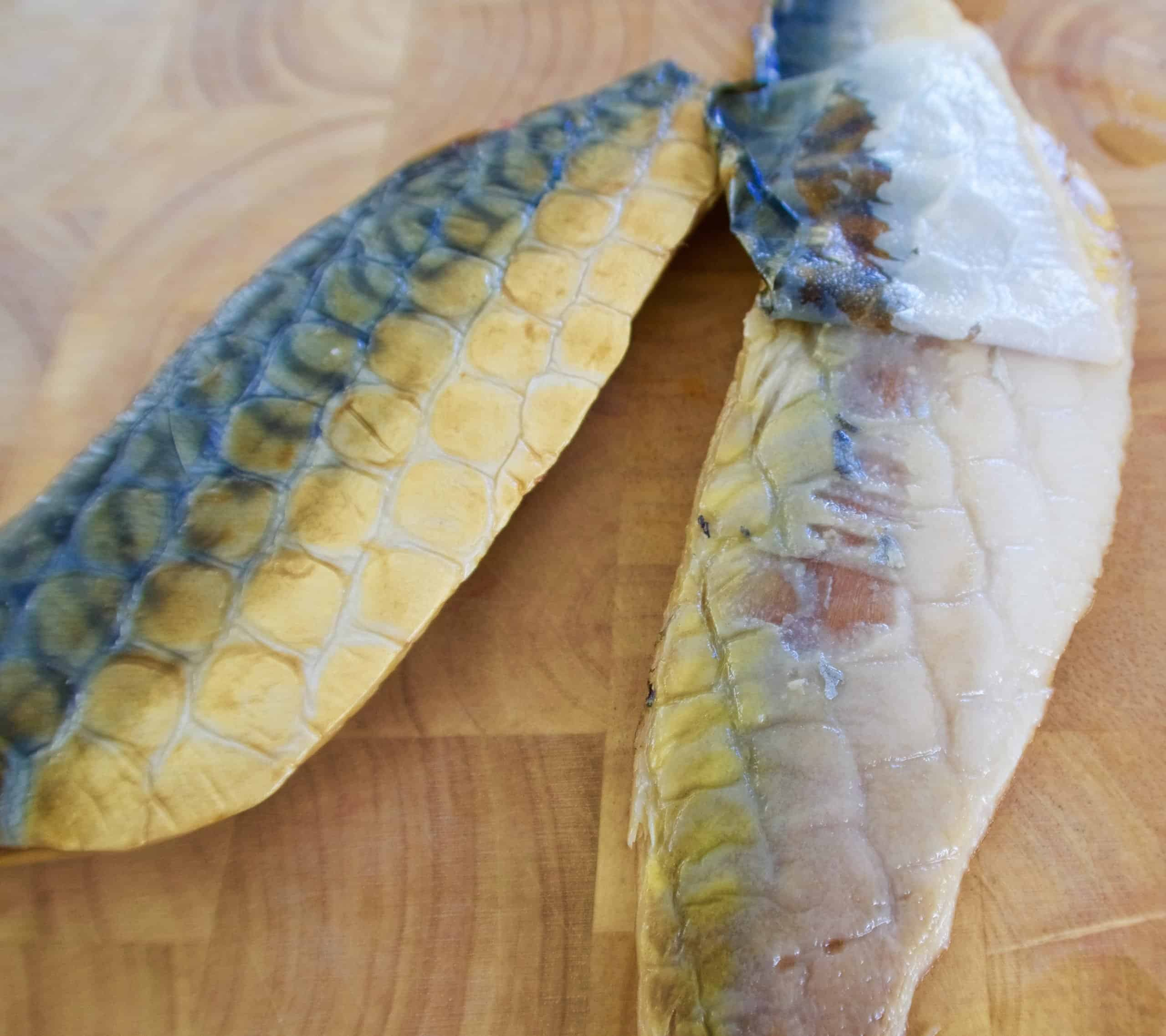 smoked mackerel pate two mackerel fillets with skin on on a wooden chopping board