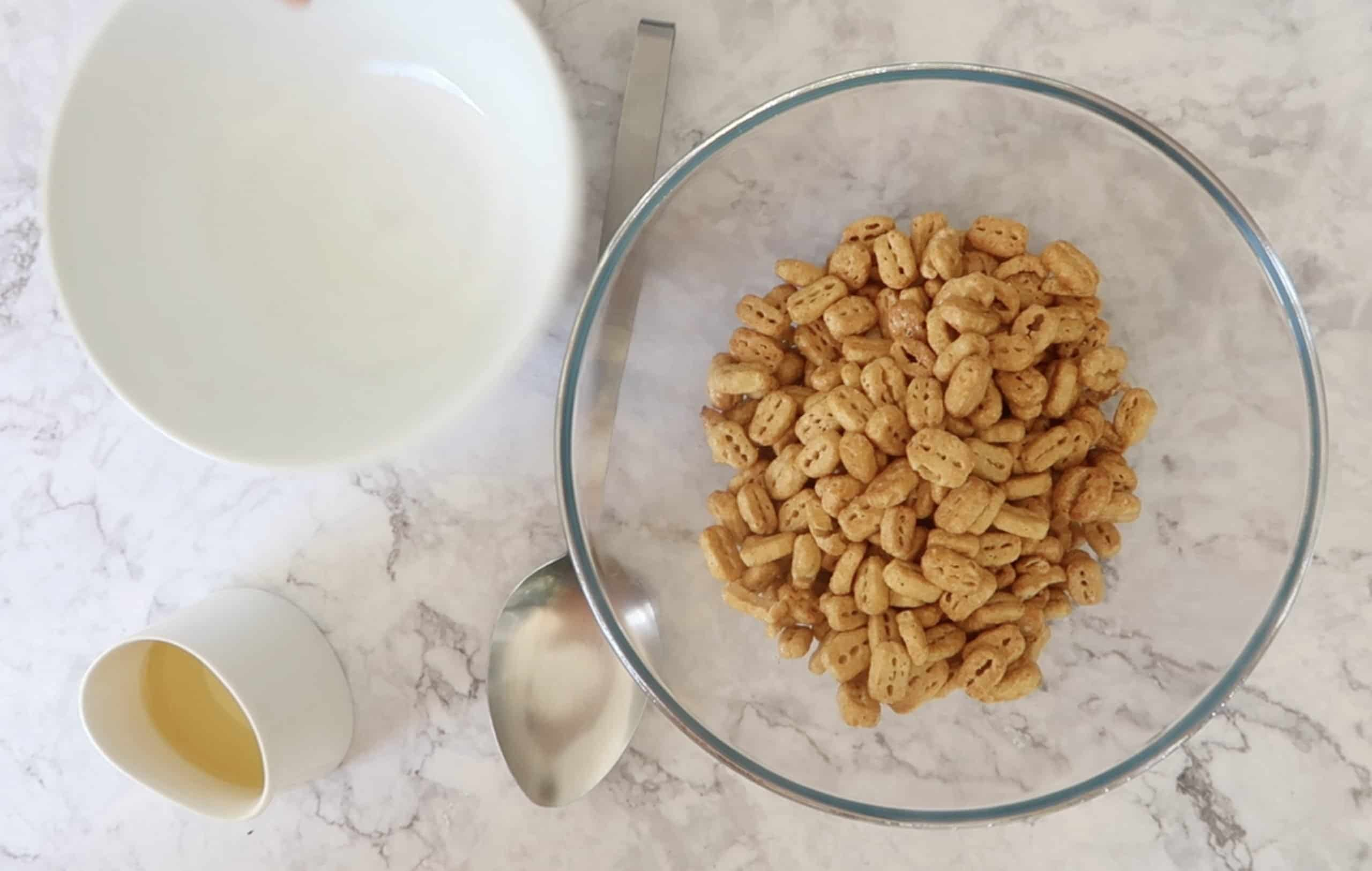 nutrigrain in a glass bowl as part of the ingredients for nuts and bolts