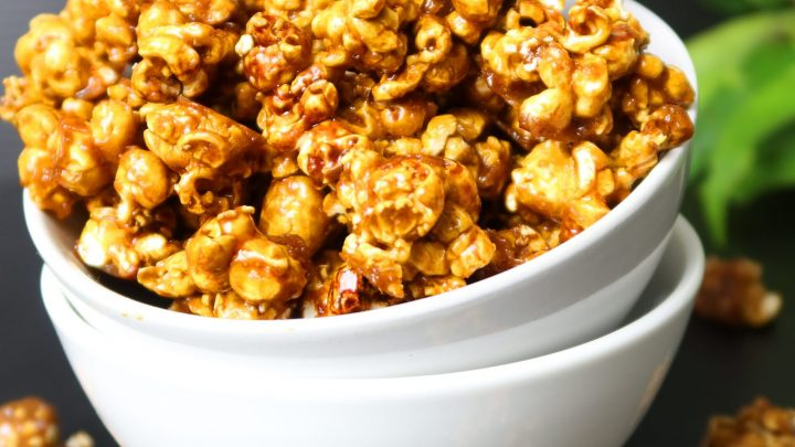 Crunchy Salted Caramel Popcorn served in a white bowl with a black background
