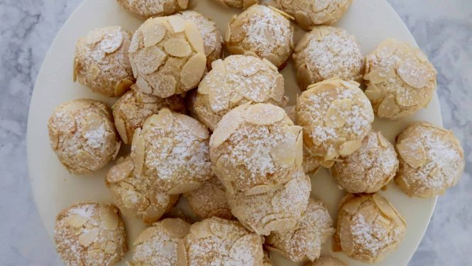 almond cookies gluten free presented on a white plate and piled high