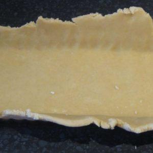 rectangle tart tin lined with pastry before blind baking to make Italian lemon mascarpone tart