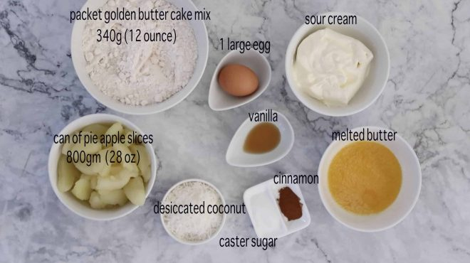 ingredients for apple and sour cream slice on a marble table