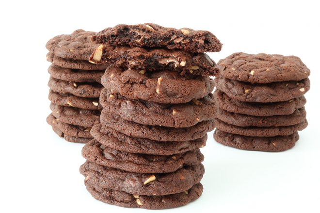 Double Chocolate Almond Cookies stacked in three piles with a white background