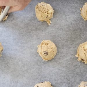 chocolate oatmeal cookies scooped onto a baking tray with baking paper