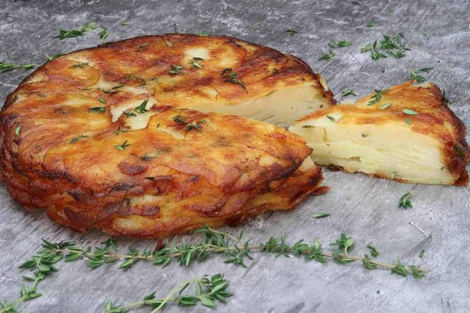 concrete table with pommes anna and thyme