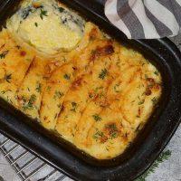 Creamy potato bake in a black pan