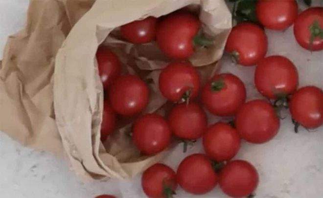 ripe tomatoes in a paper bag to make Mexican Layered Dip