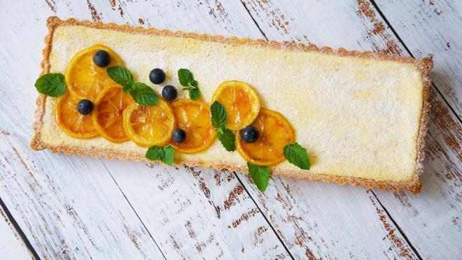 Easy Italian Lemon Mascarpone Tart on a blue board