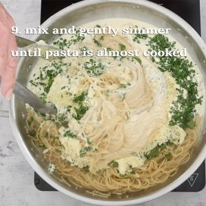mixing in the cheese and cream for Angel Hair Pasta and Chicken with Creamy Garlic Sauce