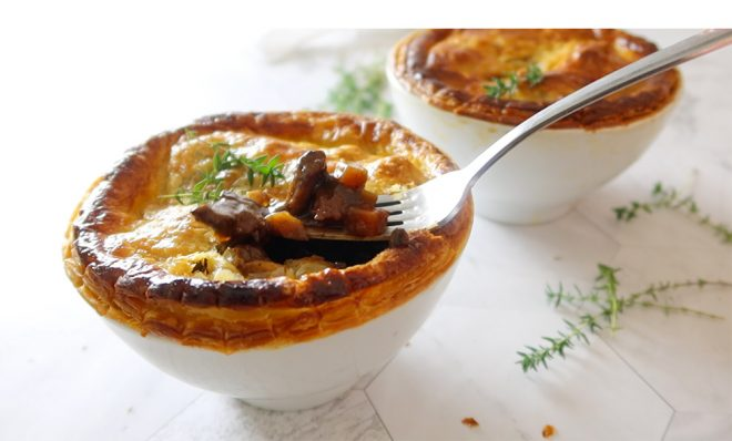 Beef Pot Pie Recipe with Mushrooms in two pots finished with crisp pastry with a fork in the middle