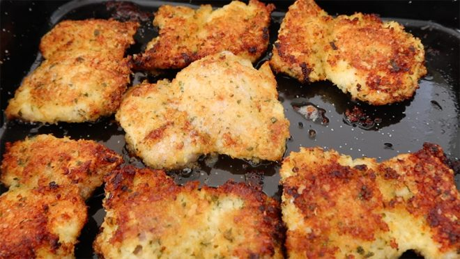 baking tray with Crispy Garlic and Parmesan Panko Chicken Thighs spread across the tray while they cook