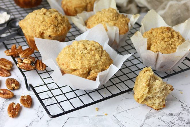 Banana Buttermilk Muffins with pecans cooling on an airing rack
