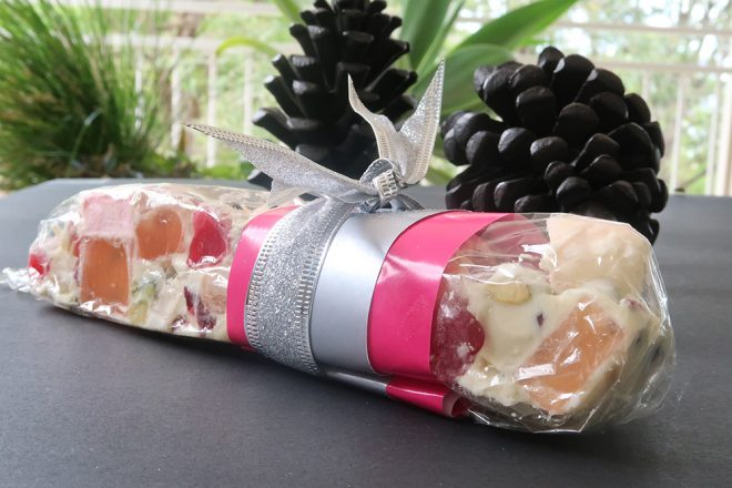 White Chocolate Rocky Road Candy Bar wrapped with silver ribbon as a gift